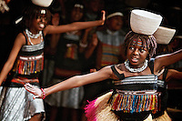 A member of the Asante children's choir performs on stage Monday with her group at Sorensen Magnet School of the Arts and Humanities.