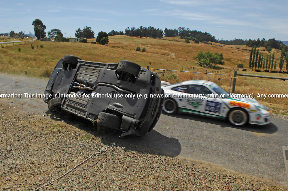 434 Frank Purdey & Peter Burrey.Accident - Car rolled on Cygnet stage..2009 Nissan GT-R R35.Day 2.Targa Wrest Point 2010.Southern Tasmania.31st of January 2010.(C) Joel Strickland Photographics.Use information: This image is intended for Editorial use only (e.g. news or commentary, print or electronic). Any commercial or promotional use requires additional clearance.