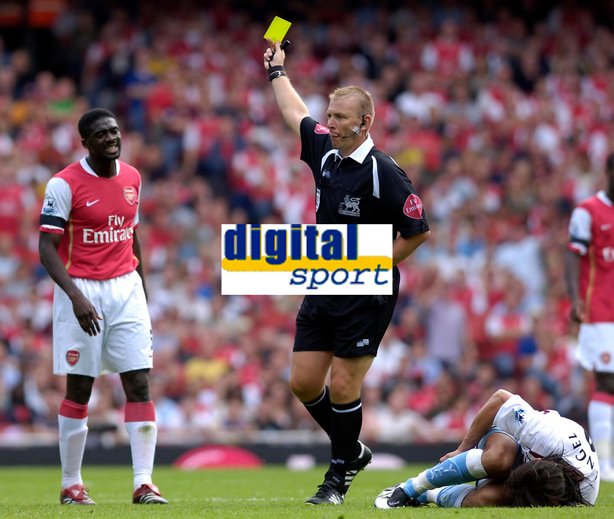 Photo: Daniel Hambury.<br />Arsenal v Aston Villa. The Barclays Premiership. 19/08/2006.<br />Arsenal's Kolo Toure (L) is booked by referee Graham Poll for a tackle on Villa's Juan Pablo Angel (on floor).