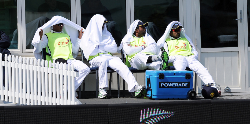 Sri Lankan non players wrap up against the cold watching against New Zealand on day four of the first International Cricket Test, University Cricket Oval, Dunedin, New Zealand, Sunday, December 13, 2015. Credit:SNPA / Ross Setford