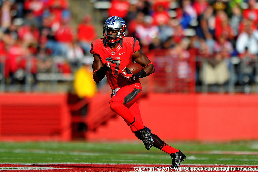 Wide receiver Brandon Coleman #17 of Rutgers runs with the ball after a reception during American Athletic Conference Football action between Rutgers and Cincinnati on Nov. 16, 2013 at High Point Solutions Stadium in Piscataway, New Jersey.
