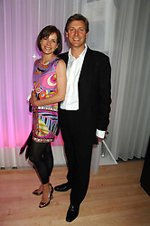 DARCEY BUSSELL and her husband ANGUS FORBES at the Lauren-Perrier 'Pop Art' Pink Party in aid of Capital 95.8's Help A London Child, held at Suka at the Sanderson Hotel, 50 Berners Street, London W1 on 25th April 2007.<br />