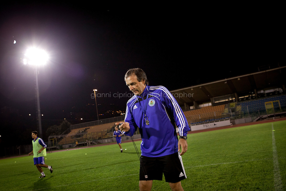 SAN MARINO, SAN MARNO - 3 OCTOBER 2011: Giampaolo Mazza, 55, coach of the San Marino national team,  trains his players at the Olympic Stadium before the upcoming and last Euro 2012 qualification game against Moldova on October 11, in San Marino on October 3, 2011. Giampaolo Mazza works as a physical education teacher at the San Marino junior high-school. Non The San Marino national football team is the last team in the FIFA  World Ranking (position 203). San Marino, whose population reaches 30,000 people, has never won a game since the team was founded in 1988. They have only ever won one game, beating Liechtenstein 1&ndash;0 in a friendly match on 28 April 2004. The Republic of San Marino, an enclave surronded by Italy situated on the eastern side of the Apennine Moutanins, is the oldest consitutional republic of the world<br /> <br /> <br /> ph. Gianni Cipriano