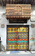Decorated door on a house in the the old town of Muharraq, Bahrain, a city on the Pearling Path and with a strong history of pearl diving and pearl trade. 17 buildings in Muharraq form part of a UNESCO World Heritage Site celebrating the pearl trade. Picture by Manuel Cohen