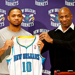 December 17, 2011; New Orleans, LA, USA; New Orleans Hornets guard Eric Gordon (10) and general manager Dell Demps at a press conference to introduce players acquired from the Los Angeles Clippers in the Chris Paul trade prior to team scrimmage at the New Orleans Arena.   Mandatory Credit: Derick E. Hingle-US PRESSWIRE