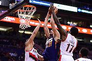 Nov 2, 2016; Phoenix, AZ, USA; Phoenix Suns center Alex Len (21) dunks the ball between Portland Trail Blazers forward Meyers Leonard (11) and forward Ed Davis (17) during the first half at Talking Stick Resort Arena. Mandatory Credit: Jennifer Stewart-USA TODAY Sports