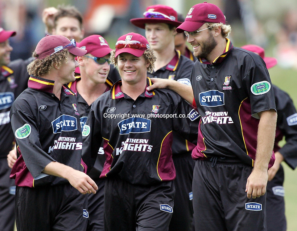 Northern Districts captain Daniel Vettori (R) celebrates with the Marshall brothers, Hamish (L) and James (R) after winning the State Shield Cricket Final against Central Districts at Pukekura Park, New Plymouth, New Zealand on Saturday, 12th February, 2005.<br />