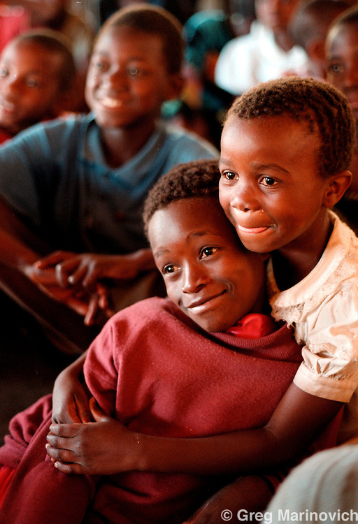 IPMG0124 Zimbabwe, Bulawayo 2000: .Mostly Aids orphans in Zimbabwe watch a play during psycho-support therapy at a Salvation Army camp, 2000. Southern Africa is the region most affected by Aids. .Photograph by Greg Marinovich / South Photographs