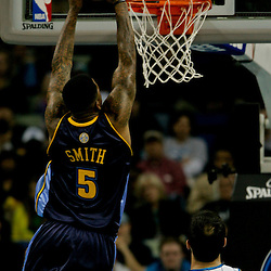 Dec 18, 2009; New Orleans, LA, USA; Denver Nuggets guard J.R. Smith (5) dunks over New Orleans Hornets forward Peja Stojakovic (16) during the first half at the New Orleans Arena. Mandatory Credit: Derick E. Hingle-US PRESSWIRE