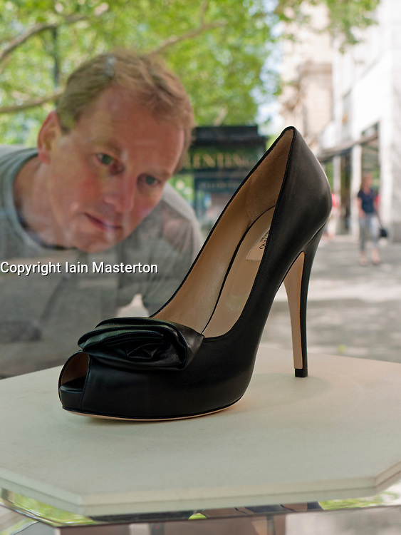 Luxury shoes on display in glass cabinets outside exclusive shops on Kurfurstendamm in Charlottenburg Berlin Germany