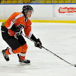WHITBY, ON - Feb 11: Ontario Junior Hockey League game between Orangeville Flyers and Whitby Fury. Matt Mercer #15 of the Orangeville Flyers Hockey Club skates with the puck during first period game action.<br /> (Photo by Shawn Muir / OJHL Images)