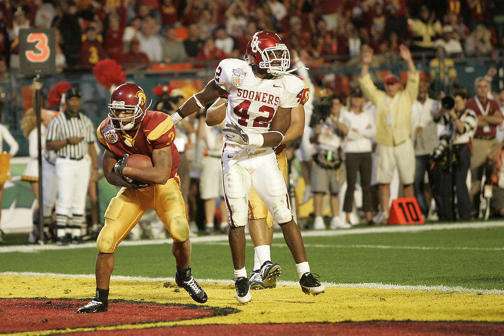 University of Southern California wide receiver Steve Smith catches a pass for a touchdown as Oklahoma University linebacker Rufus Alexander defends during USC's 55-19 victory over OU on January 4, 2005 in the FedEx Orange Bowl at Pro Player Stadium in Miami, Florida.