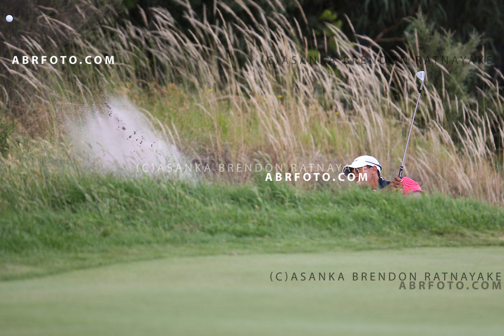 20 November 2011 : Tiger Woods chips out of the bunker during the fifth-round Sunday Final round single ball matches at the Presidents Cup at the Royal Melbourne Golf Club in Melbourne, Australia. .