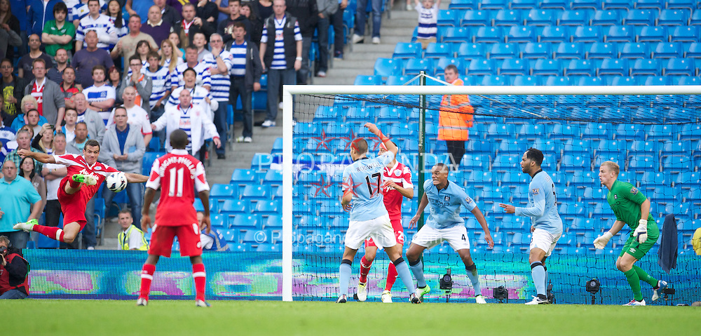 MANCHESTER, ENGLAND - Saturday, September 1, 2012: Queens Park Rangers' Ryan Nelsen sees his shot go wide against Manchester City during the Premiership match at the City of Manchester Stadium. (Pic by David Rawcliffe/Propaganda)
