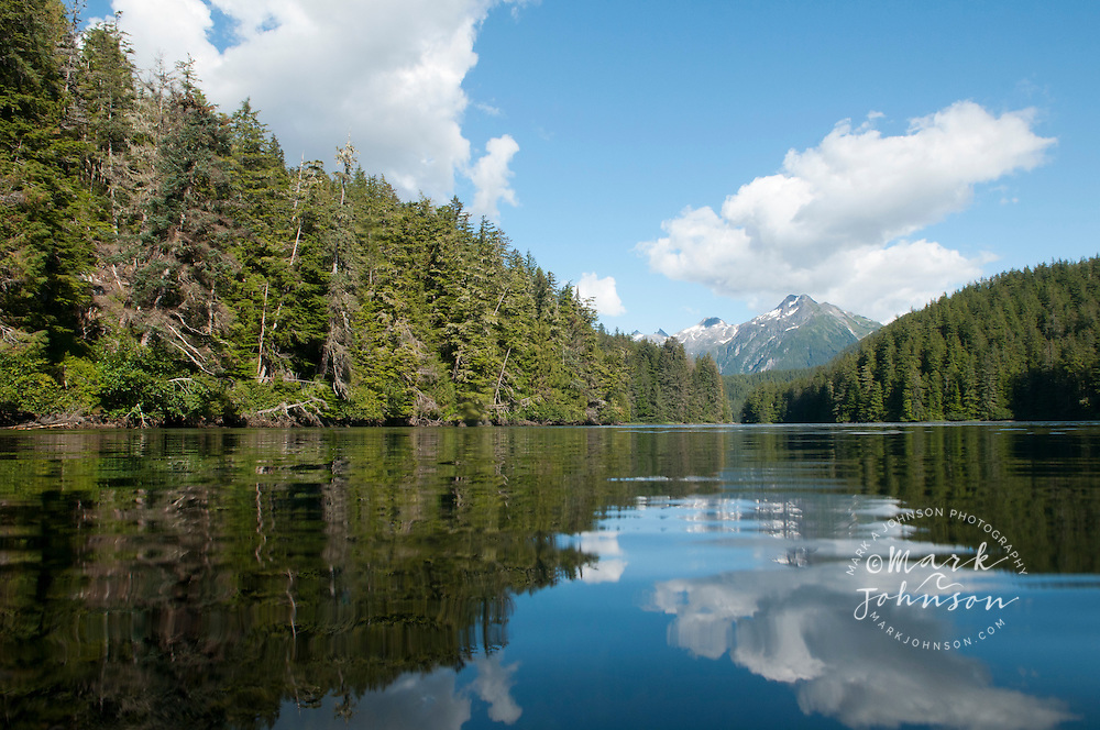 Mountains reflected in calm water, Tongass National Forest, Alaska