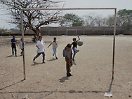 COYOLITO (Tejutla), CHALATENANGO, EL SALVADOR- MAY 2000: A group of school children play a game of futbol (soccer) in a school yard in Departamento de Chalatenango.   (Photo by Robert Falcetti). .