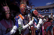 PERU: Cuzco Region.Masked dancers mimicking the Spanich at the festival of Corpus Cristi at Paucartambo.