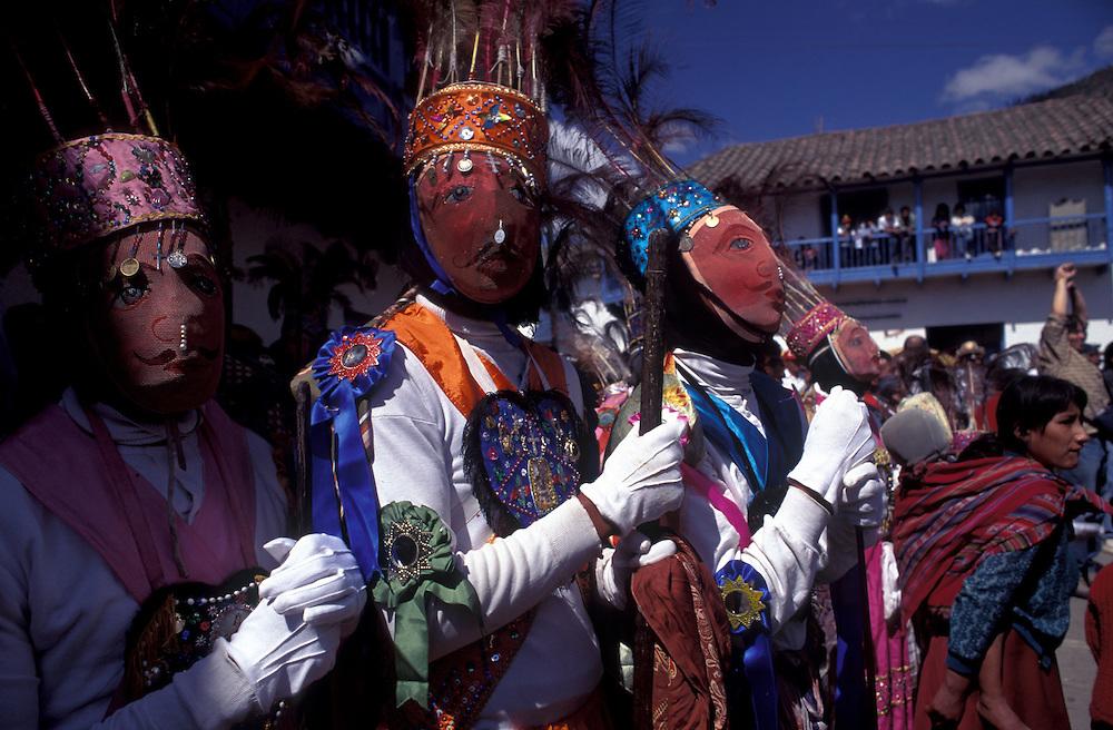 PERU: Cuzco Region.Masked dancers mimicking the Spanich at the festival of Corpus Cristi at Paucartambo.