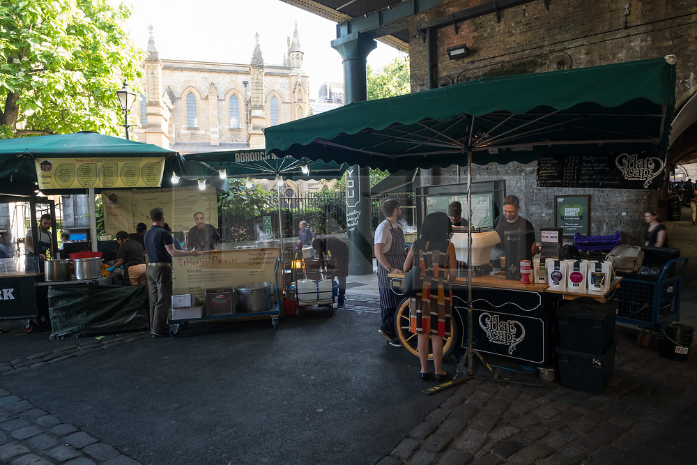 © Licensed to London News Pictures. 14/06/2017. London, UK. Shop owners and stall holders prepare to open for business as Borough Market re-open on the first day of trading after the terrorist attacks 3rd June which left eight people dead and three terrorists shot dead by police. Photo credit: Ray Tang/LNP