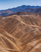 Fascinating landscape at Zabriskie Point. Zabriskie Point is a part of Amargosa Range, east of Death Valley in Death Valley National Park in California, noted for its erosional landscape. It is composed of sediments from Furnace Creek Lake, which dried up 5 million years ago—long before Death Valley came into existence