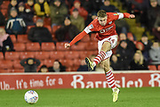 Kilian Ludewig (14) of Barnsley FC shoots at goal during the EFL Sky Bet Championship match between Barnsley and Preston North End at Oakwell, Barnsley, England on 21 January 2020.