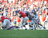 Ole Miss defensive back Cody Prewitt (25) tackles Georgia running back Todd Gurley (3) at Sanford Stadium in Athens, Ga. on Saturday, November 3, 2012.