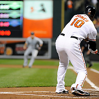 09 June 2009:  Baltimore Orioles center fielder Adam Jones (10) grounds into a fielders choice that scores second baseman Brian Roberts in the 1st inning against the Seattle Mariners at Camden Yards in Baltimore, MD.  The Orioles defeated the Mariners 3-1.  ****For Editorial Use Only****