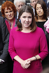 © Licensed to London News Pictures. 30/09/2019. London, UK. Liberal Democrat Leader Jo Swinson stands with party members a she makes a statement outside Parliament after a meeting of opposition leaders was held to discuss a plan to force the Prime Minister to go to Brussels to seek another Brexit delay as early as this weekend. Photo credit: Peter Macdiarmid/LNP