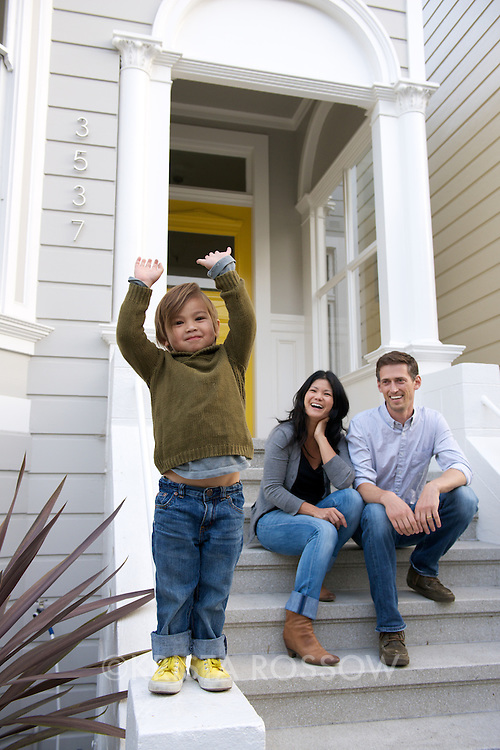 Brad Olcott and Julie Chan with their son Rye (3 years old) in the Mission District of San Francisco. Portraits taken in front of their hous, walking in their neighborhood, and in Mission Dolores park. Brad and Julie rent out a room in their home or their entire home through AirBnB. https://www.airbnb.com/users/show/648553. Contact: Brad Olcott, brad@bpocreative.com, 415-235-5334.