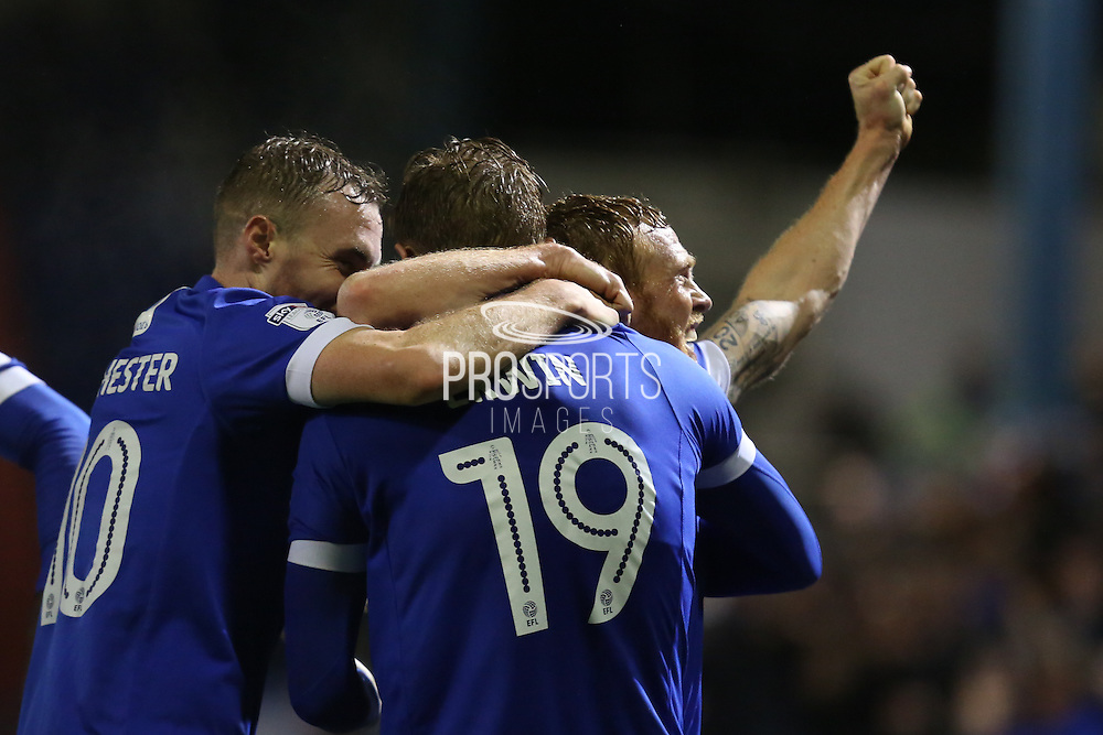 Lee Erwin of Oldham Athletic celebrates with his team mates Kallum Mantack and Paul Green of Oldham Athletic during the EFL Sky Bet League 1 match between Oldham Athletic and Scunthorpe United at Boundary Park, Oldham, England on 18 October 2016. Photo by Simon Brady.