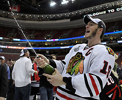 June 9, 2010; Philiadelphia, PA; USA;  Chicago Blackhawks center Jonathan Toews (19) sprays champagne after the Blackhawks defeated the Flyers 4-3 in Game 6 of the Stanley Cup Finals at the Wachovia Center.