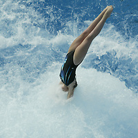 Elisabeth Tatum, 12, of Ft Lauderdale, learns how to performs a reverse 1 1/2 tuck at the International Swimming Hall of Fame Pool in Ft Lauderdale, FL on May 14, 2003. The bubbles were turned on in the pool so youngsters will not hurt their head if they don't perform the dive properly.  (Photo by Preston Mack)