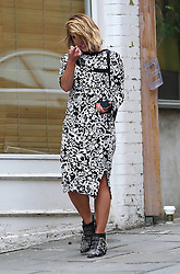 (EXCLUSIVE PICTURES) Actress Billie Piper wearing a black & white floral pattern dress and a pair of Chloé Susannah studded ankle boots visits a nail salon in north London, UK. 17/04/2014<br />