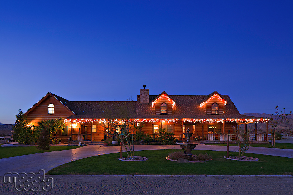 Façade of ranch home at dusk