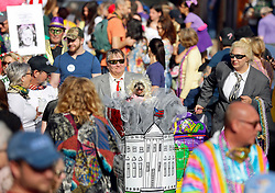 31 January 2016. New Orleans, Louisiana.<br /> Mardi Gras Dog Parade. Crowds with the Mystic Krewe of Barkus as the parade winds its way around the French Quarter with dogs and their owners dressed up for this year's theme, 'From the Doghouse to the Whitehouse.' <br /> Photo©; Charlie Varley/varleypix.com