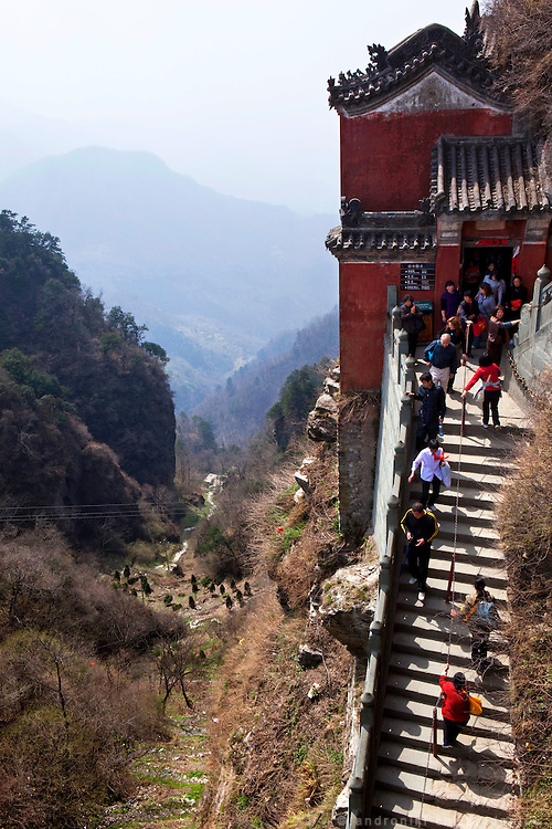 Asia, China, Hubei province.  Pilgrims climbing the many stept to the top of the Golden Palace on the Heavenly Pillar Peak of Wudang moutain (Wudang-san), a World Heritage mountain with many Taoist monasteries.