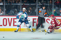 REGINA, SK - MAY 19: Josh Anderson #3 of Swift Current Broncos passes the puck away as Antoine Morand #88 of Acadie-Bathurst Titan skates in for the check during first period  at the Brandt Centre on May 19, 2018 in Regina, Canada. (Photo by Marissa Baecker/CHL Images)