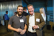 Victor Frandsen of Code for San Jose (left) and John Mein of Petzila pose for a portrait during the Silicon Valley Business Journal's HHaaS Tech Mixer at ZERO1 in San Jose, California, on May 28, 2015. (Stan Olszewski/SOSKIphoto for the Silicon Valley Business Journal)