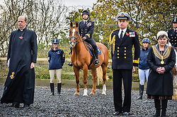 Royal Navy Officer Lieutenant Gary Smith sits in silence on Zabor during the first ever memorial service dedicated to horses killed or injured in conflict, at the Royal Navy and Royal Marines Riding Stables at Bickleigh Barracks, Plymouth.