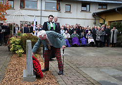 Veteran Peter Knowles (left) from the Royal Army Service Corps lays a wreath on behalf of the Erskine Veterans during a Service of Remembrance on Armistice Day at Erskine Home in Bishopton, Scotland.