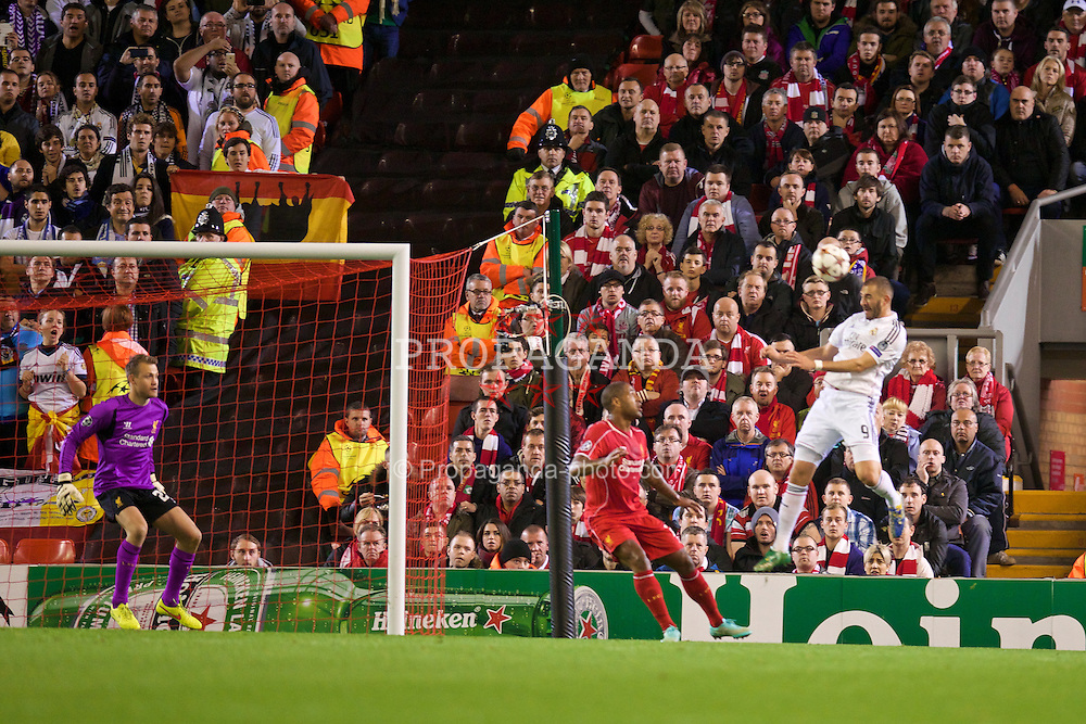 LIVERPOOL, ENGLAND - Wednesday, October 22, 2014: Real Madrid CF's Karim Benzema scores the second goal against Liverpool during the UEFA Champions League Group B match at Anfield. (Pic by David Rawcliffe/Propaganda)