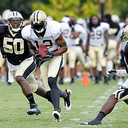July 28, 2012; Metairie, LA, USA; New Orleans Saints wide receiver Marques Colston (12) catches a pass over linebacker Curtis Lofton (50) during a training camp practice at the team's practice facility. Mandatory Credit: Derick E. Hingle-US PRESSWIRE
