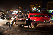 Motorists push their vehicle through a busy intersection near the slum of Dandora in Nairobi, Kenya.