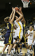08 February 2007: Iowa center Stacy Schlapkohl (40) tries to shoot while being guarded by Michigan forward Carly Benson (21) and forward Stephany Skrba (13) in Iowa's 66-49 win over Michigan at Carver-Hawkeye Arena in Iowa City, Iowa on February 8, 2007.