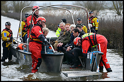 Prince Charles on a rescue boat as visiting Flood Victims on the Somerset Levels, South West England. Members of the community have been cut off by the floods for most of 2014. Tuesday, 4th February 2014. Picture by Andrew Parsons / i-Images