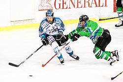 Anze Ropret of HDD Telemach Olmpija vs Patrick Spannring of EHC Liwest Linz during ice-hockey match between HDD Telemach Olimpija and EHC Liwest Linz in EBEL league, on December 30, 2015, in Hala Tivoli, Ljubljana. Photo by Morgan Kristan / Sportida.