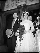 18/02/1957<br /> 02/18/1957<br /> 18 February 1957<br /> Wedding Dr K. Murphy and J. Fitzgerald at St. Mary's Church, Haddington Road and reception at Salthill Hotel, Monkstown. Bride and Groom and Bestman and Bridesmaid leaving the church after the ceremony.