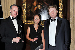 Left to right, EWEN CAMERON, ANASTASIA SHATALOVA and HENRY GWYN-JONES at a dinner in aid of Caring For Courage - The Royal Scots Dragoon Guards Afghanistan Welfare Appeal held at The Royal Hospital Chelsea, London SW3 on 20th October 2011.