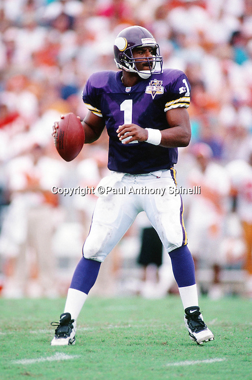 Minnesota Vikings quarterback Warren Moon (1) throws a pass during the NFL football game against the Tampa Bay Buccaneers on Oct. 15, 1995 in Tampa, Fla. The Bucs won the game 20-17 in overtime. (©Paul Anthony Spinelli)