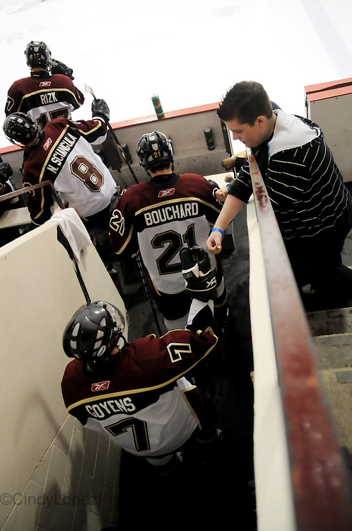 Concordia Stingers Defenseman Nicholas Goyens (7) fist bumps a young fan before hitting the ice at The Ed Meagher Arena. (Published in The Concordian, 2010)
